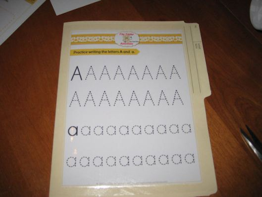 6- Repeat the process for the third activity page and laminate it onto the back of the folder.