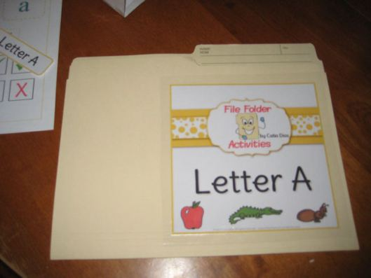 7- Cut thebig label and laminate it onto the front of the folder. Make sure you place it towards one of the sides in order to leave room for the CD envelope.