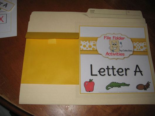 9- ... and paste it onto the file folder, side by side with the big label.