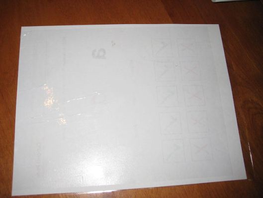12- Place another piece of material onto the back of the cut-outs page.