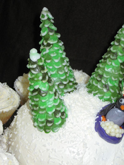 """Detail of trees. Each """"branch"""" was cut separately, attached to the sugar cone and then iced with royal-icing to mimic snow."""